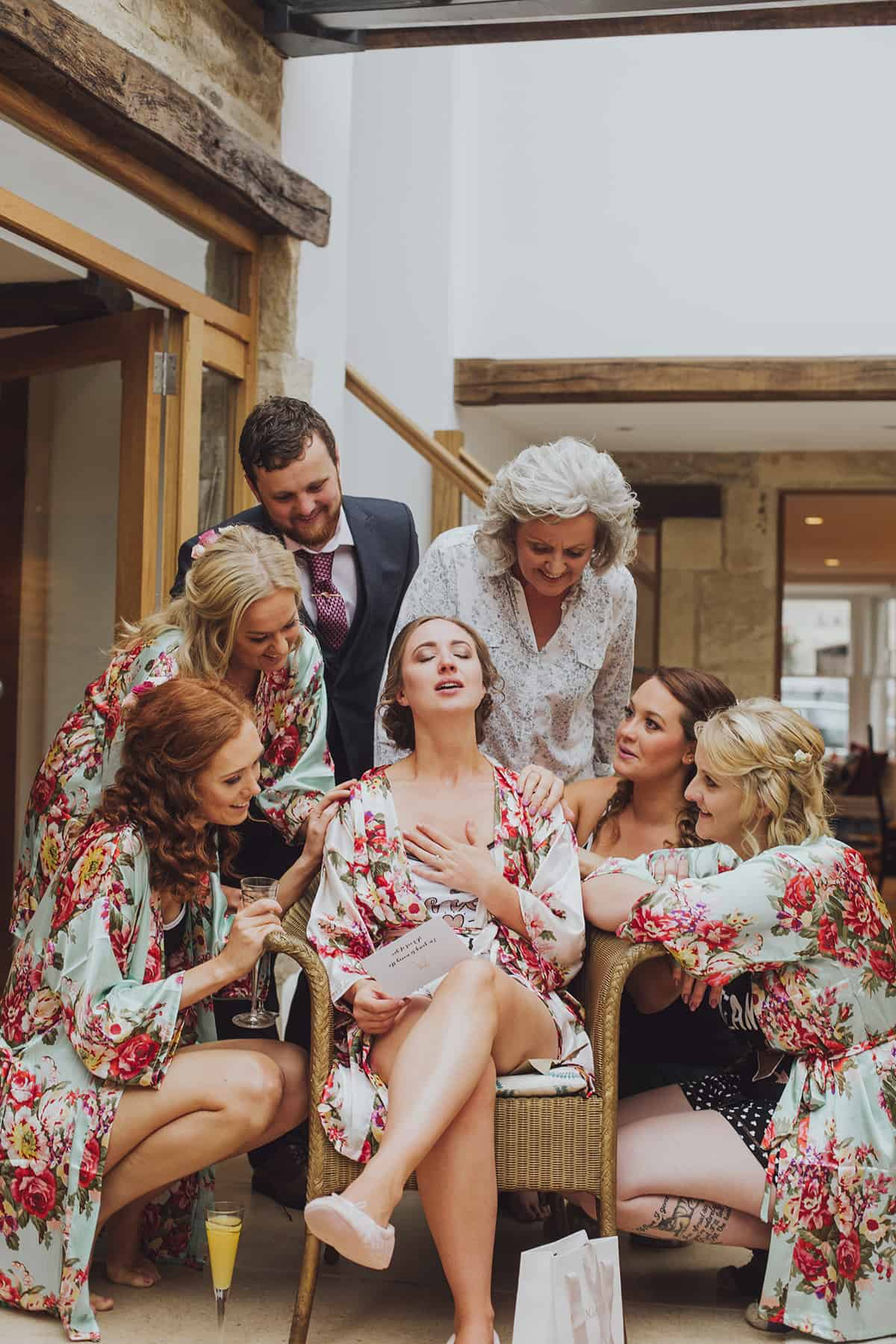 Bride opens gifts surrounded by bridesmaids