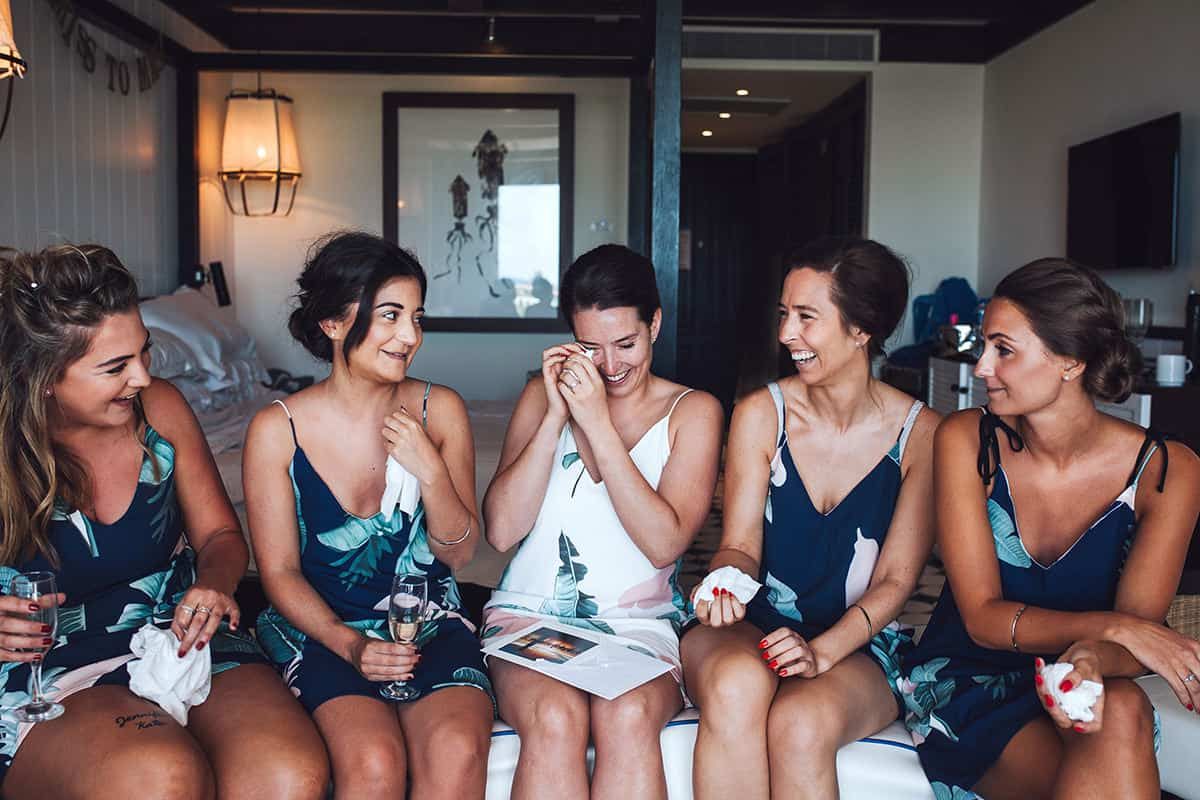 Bride and bridesmaids giving gifts and getting emotional in mexico