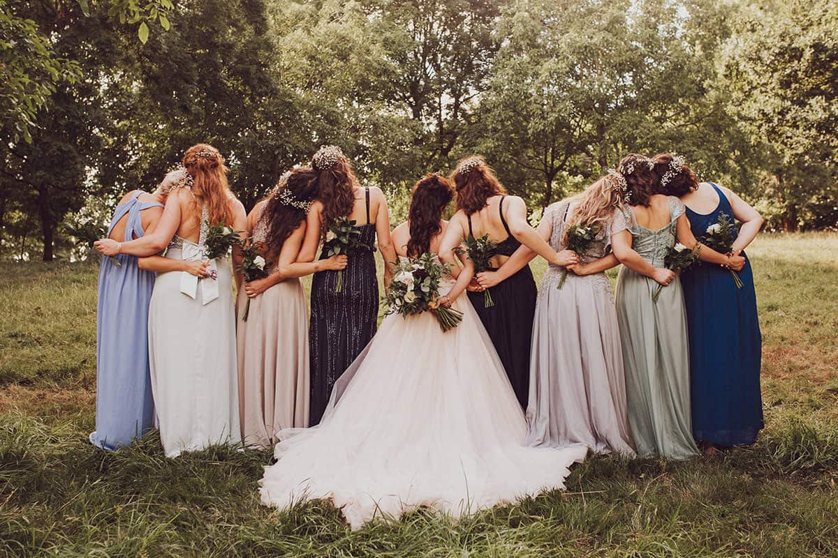 Boho wedding mismatched bridesmaids in the forest
