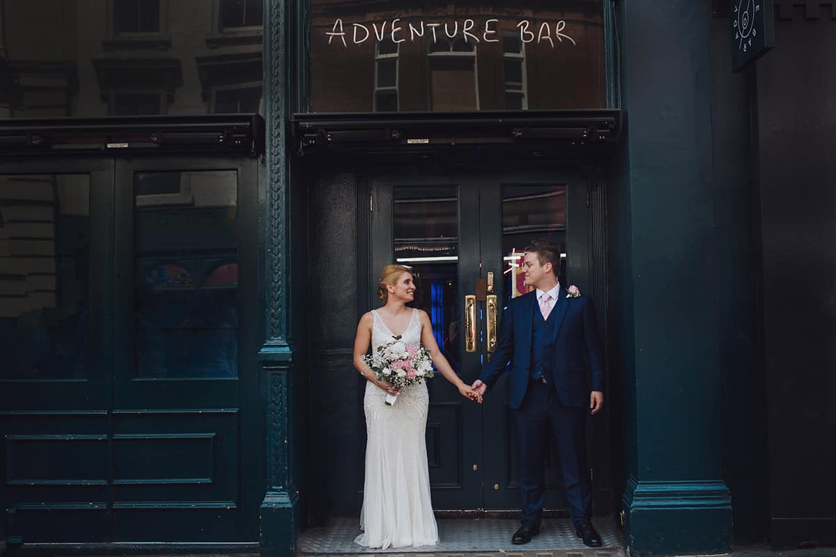 Bride and Groom outside Quirky London bar