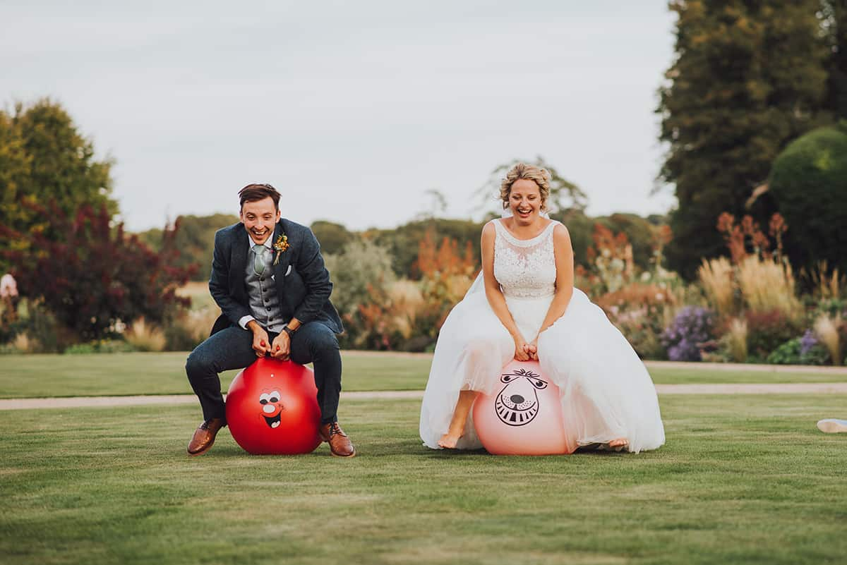 bride and groom on space hoppers