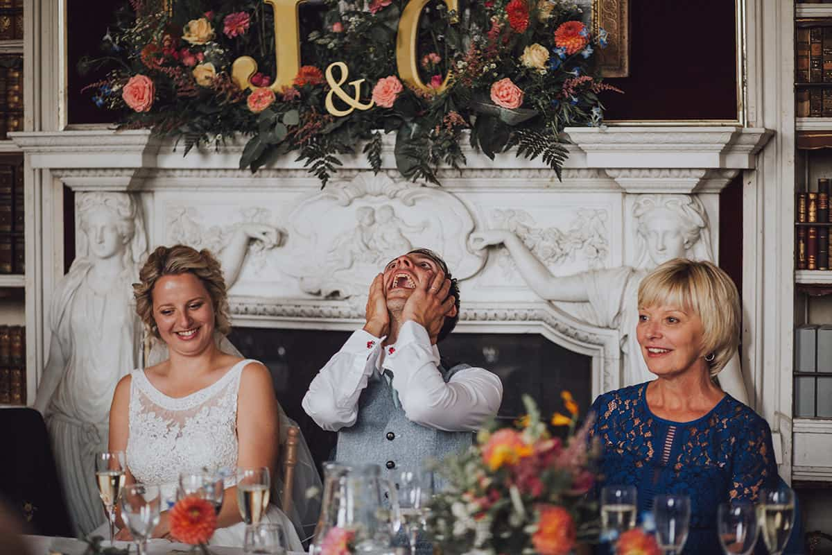 Groom reacting to wedding speeches at St giles house