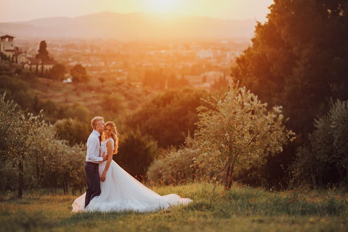 bride and groom in olive groves in Italy at sunset