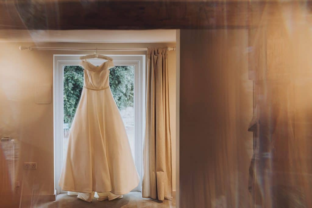 wedding dress hanging up at sopley mill