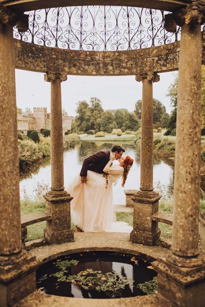 bride and groom kissing in forde abbey