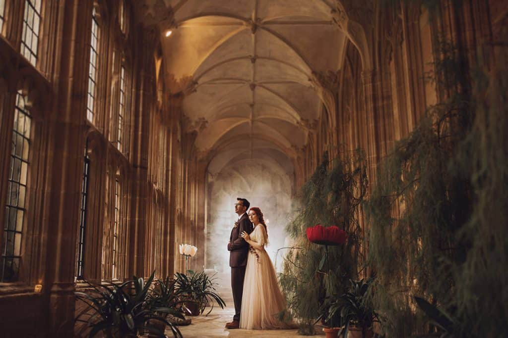 bride and groom in cloisters at forde abbey