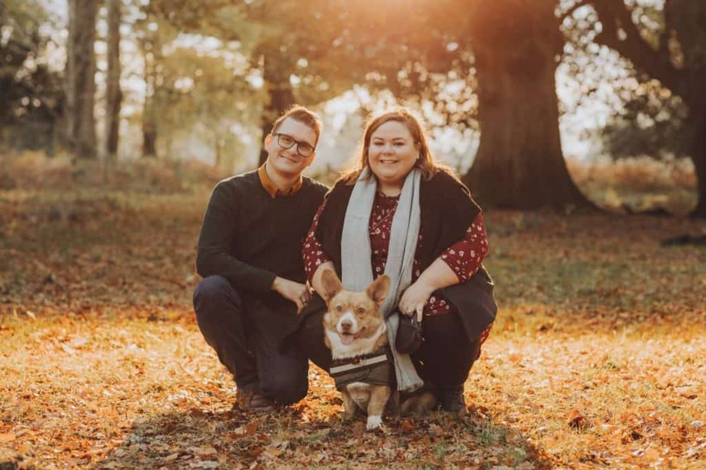Couple and their corgi dog in autumn at their forest of dean engagement shoot