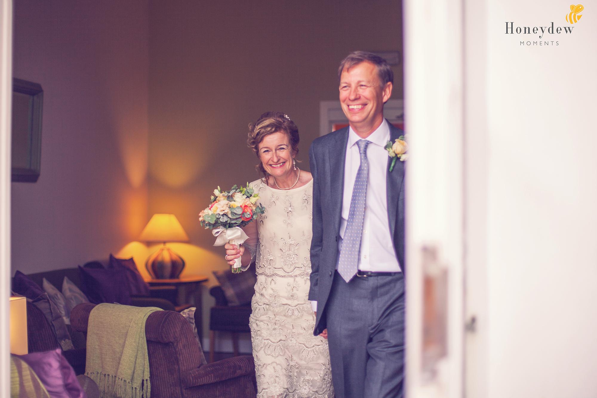 an older bride and groom walk through hotel doors